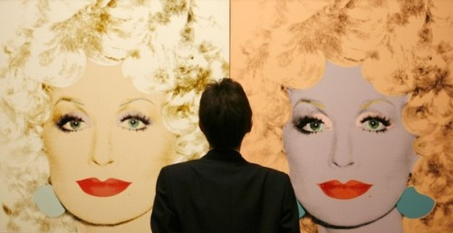 "Someone standing in front of Warhol's ""Dolly Parton"""