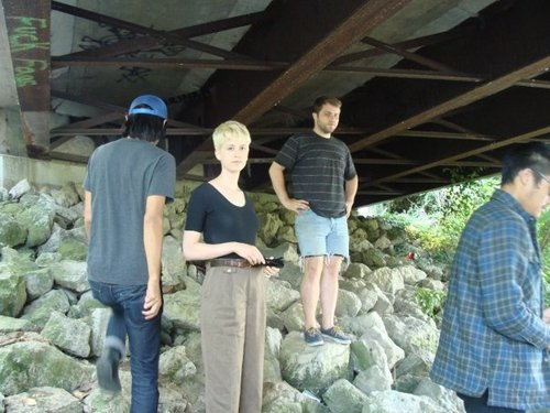 Tessa under a bridge somwhere while on tour