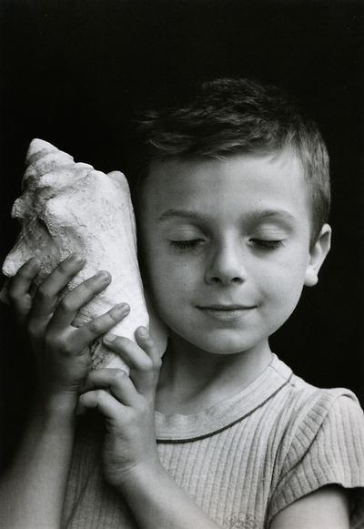 Édouard Boubat - Rémi holding a shell, Paris, France, 1995 (via smut-to-go)